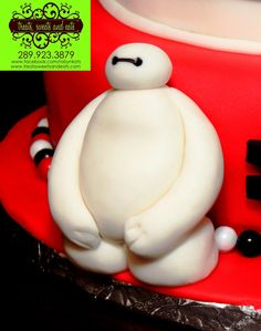 Big Hero 6 Birthday Cake (Baymax Fondant Figure Close-Up)!!! Happy 7th Birthday again, Lucas!!! If anyone is interested in having a custom made Birthday (or any other occasion) sugar art, cakes, cupcakes, cake pops, macarons, sugar flowers (or any other baked goods) with *FREE DELIVERY* in the GTA / Golden Horseshoe area, please contact Robyn at robyn@treatssweetsandeats.com, or at 289-923-3879!!! Please feel free to 'Share' this photo!!! Please contact us for more information!!!