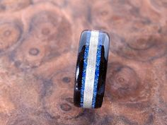 Hey, I found this really awesome Etsy listing at https://www.etsy.com/listing/155760025/ebony-wooden-ring-with-lapis-lazuli-and