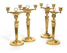 Two pairs ofgilt-bronze candlesticks Empire, circa 1810   Lot   Sotheby's