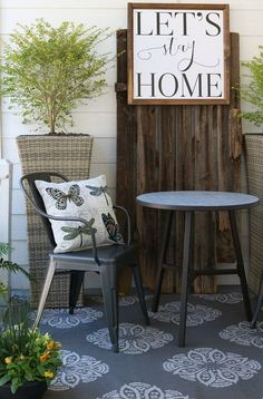 Metal farmhouse chairs, indoor/outdoor rug look great with the shiplap wall and barn wood door. Farmhouse porch makeover with Better Homes and Gardens at Walmart #sponsored