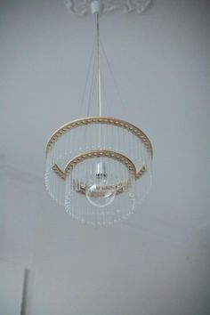 Beautiful test-tube chandelier from Polish designer Pani Jurek.  Lovely alone but can also be used filled with water and flowers.      http://remodelista.com/posts/gardens-in-the-sky-test-tube-chandeliers-from-poland?utm_source=Remodelista+Daily+Subscriber+List_campaign=5f5a97a3e1-RSS_EMAIL_CAMPAIGN_medium=email