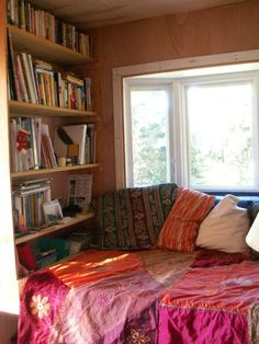 Perhaps a built-in daybed flanked by bookshelves at the back of the house, which can be closed off with curtains