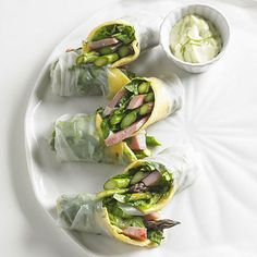 Shrimp spring rolls are spiced up with fresh mint and a vibrant parsley chimichurri. This recipe tastes just like the spring roll appetizer you order at your favorite Asian restaurant!