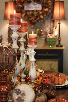tablescape the White candle holders with the orange candles are so pretty.