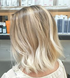 Lived in hair colour Blonde brunette golden tones Balayage face framing blonde Textured curls
