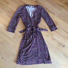 """DVF wrap dress Authentic DVF silk dress.  Classic style and a bold, fun pattern make this piece a hit for work or a night out on the town. 37"""" from shoulder to hem. 3/4 sleeves Diane von Furstenberg Dresses Midi"""