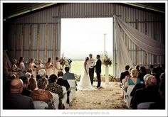 The weather forced what was meant to be an open-air wedding into a hay-shed. It turned out to be a gorgeous venue for this farm wedding
