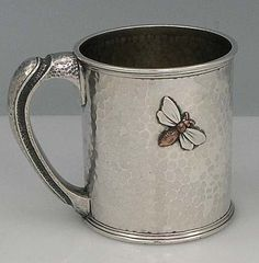 Whiting sterling silver cup, c1880,  with mixed metal application and fine hand hammered handle. Applications include a copper bee with silver wings and a large copper cherry branch with brass leaves.