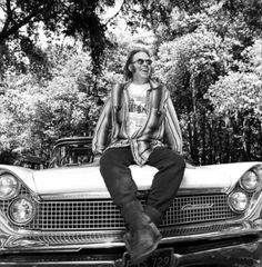 Neil Young sitting atop his 1959 Lincoln Continental