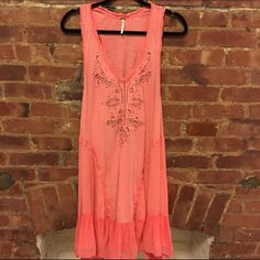 FREE PEOPLE coral dress Adorable Free People hot pink dress. Flowy. Light cotton material. Perfect condition. 🚫 Trades. Reasonable offers are welcomed :) Free People Dresses Mini