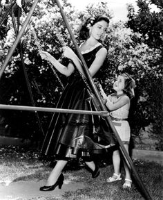 Pier Angeli at home on the swings with little sister Patrizia, 1950s.