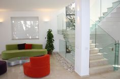 2-bold-furniture-seating-glass-staircase