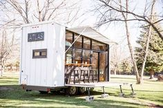Atlas tiny house comes with its own fold-down patio bar | TreeHugger