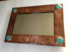 Mirror frame with Ruskin stones.