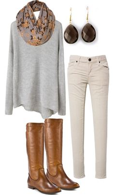 Oat-colored Pants and an Over Sized Light Grey Heather Sweater with a Dark Scarf, Earrings, and Brown Boots