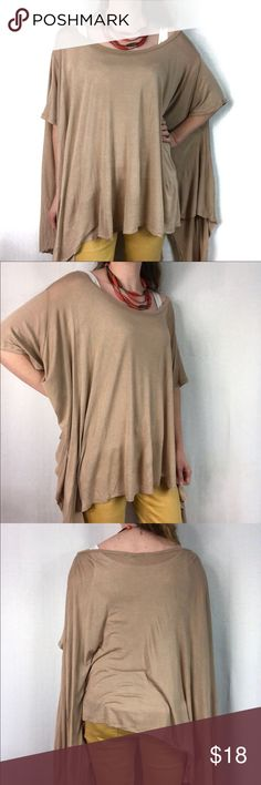 "Oversized Off-the-Shoulder Tunic Flowy viscose in a neutral camel color!  Oversized top with a wide scoop neckline can be worn as a boat neck or off the shoulder!  Short loose sleeves with a hem that is uneven in the front and straight across the back!  Great casual look with leggings or jeans!  Perfect condition!  One Size, shown on a size small model.  Lots of room in the torso!  43"" across the bust.  22"" from the back of the neck to the back hem, the shortest part of the front hem is…"