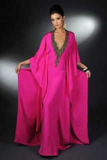 Kaftan!  I see myself walking about the house with a glass of wine or better, champagne :)
