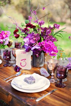 radiant orchid centerpiece, photo by Arina B Photography http://ruffledblog.com/purple-inspired-wedding-ideas #weddingideas #inspiration #centerpieces