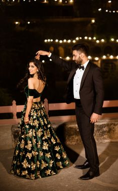 Candid Couple Shots - Bride in an Green Lehenga with Golden Embroidery   WedMeGood #wedmegood #indianbride #indianwedding #lehenga #receptionoutfits #emerald