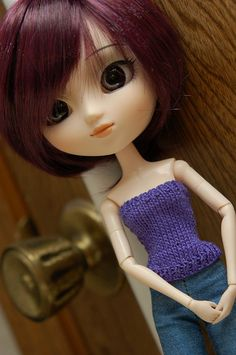 Strapless top (or tank top - just add straps) for Pullip dolls. Is stretchy and will probably fit Obitsu S and M bodies, but you may want to go down a size for Blythe dolls. Not entirely sure since I don't own both dolls to compare.