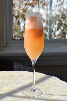 The Best Mimosa Recipe! This Mimosa Recipe uses Orange Sherbet instead of Orange Juice! PERFECT for a Summertime Brunch!