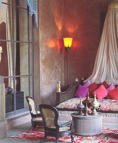 exotic dreaming with tadelakt walls, drifting bed hangings, worn rugs and aladdin's lamp accessories