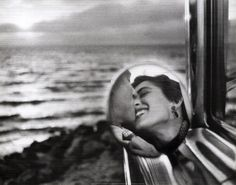 I love this candid moment of a kiss caught in a side rear view mirror, by Elliot Erwitt