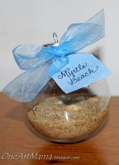 collect sand or stones from honeymoon put it in ornament.. This is such a neat idea!