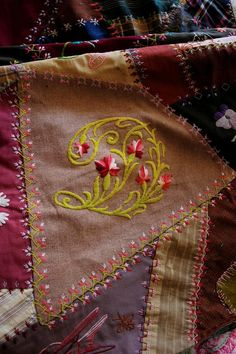 I ❤ embroidery & crazy quilting . . . beautiful work on this one. Would really like to see the whole quilt . . .