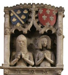 All Saints Church, Bakewell - Since 1376 Godfrey and Avena de Foljambe, Lord Chief Justice of Ireland, have appeared to look out of a window.