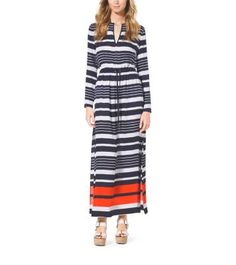 """An airy maxi dress travels well, and works seamlessly from day to night,"" says Michael. Featuring a drawstring waist and playful pop of color at the hem, our striped design is perfect for winter escapes and will transition you effortlessly into warmer climes. Team it with a bold bucket bag and wedge sandals."