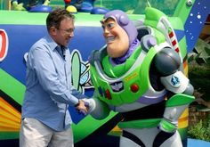Buzz Lightyear shaking hands with Tim Allen. This is beautiful.