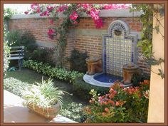 mexican style water feature - this is it! i'm going to make something like this for the back patio area... :)  square off the base, make it a little wider / deeper, *maybe* put some koi in it..