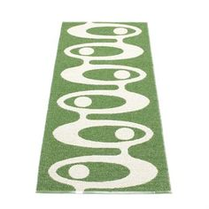 The green and white Alve woven plastic carpet comes from the Swedish company Pappelina, and is available in four sizes.