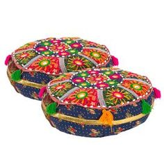 "Set of cotton poufs with vibrant tassel trim and medallion detail.   Product: Set of 2 poufsConstruction Material: CottonColor: MultiFeatures:  HandcraftedTraditional design Dimensions: 4"" H x 16"" Diameter eachCleaning and Care: Spot clean"