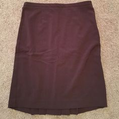 NWOT brown moda skirt Brown skirt bought from Victorias Secret was never worn NWOT has just been stored away and recently found. Has stretch and very cute back pleets Moda International Skirts