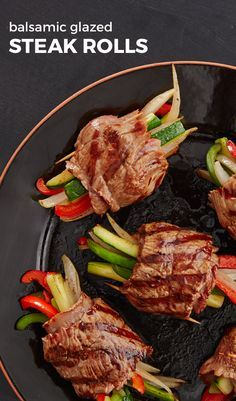 Tender steak rolls filled with zesty vegetables and drizzled with a glaze that is simply out of this world delicious. Tender cuts of beef are rubbed down with olive oil, freshly ground black pepper and chopped rosemary, then stuffed with strips of sautéed bell peppers, onion, zucchini, and mushrooms. They're rolled up, grilled, and then drizzled with a balsamic vinegar glaze that is infused with garlic, fresh rosemary, and a touch of brown sugar.