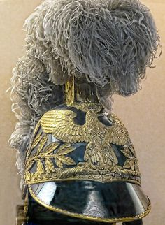 One of Napoleon's plumed helmets emblazoned with gold imperial eagle 19th century CE  Royal Palace of Fontainebleau