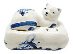 Delft Blue collectible Salt and Pepper Set of Cat laying on pillow. Cat serves as salt shaker and the separate piece of the pillow serves as the pepper shaker. - Hand painted - See our collection for