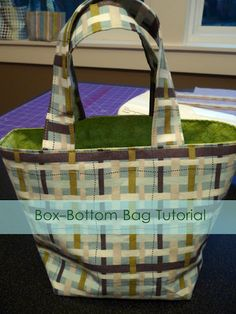 How to Sew a Box-Bottom Bag    This tutorial is awesome! Revisiting this tutorial because I use it ALL the time. (I've made 5 of these bags so far) the only thing I change (other than the size based on my needs) is that I now have added batting to the mix to thicken up the bag. This last time I also added an extra folded rim which I believe made it look much more complete.
