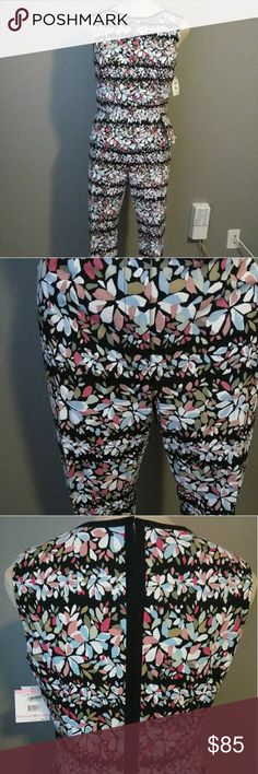 WOMEN'S NEW GENUINE ANNE KLEIN PANTS SET/SUIT *BLACK BACKGROUND WITH MAUVE, LIGHT BLUE, PINK, TAN, OLIVE, AND WHITE FLORAL DESIGN; MAKING IT AN EASY MATCH FOR MULTIPLE SHOES AND ACCESSORIES TOP *SLEEVELESS DESIGN WITH BLACK TRIMMING AROUND THE SHOULDERS, NECKLINE, AND A SEAM STRAIGHT DOWN THE BACK *PEPLUM WAIST WITH A FOLDED, PLEAT DESIGN FOR ADDED FLARE *LEFT SIDE HIDDEN ZIPPER FOR EASY ON/OFF (pic) *HOOK CLOSURE AT THE TOP WITH A LITTLE PEEP OPENING IN THE MIDDLE (pic) PANTS *CAPRIS…