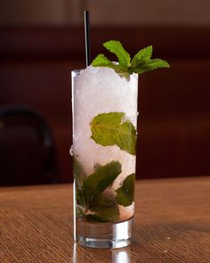 Swizzled Mojito: spearmint, Bacardi, lime, simple syrup, Angostura bitters, Peychaud bitters