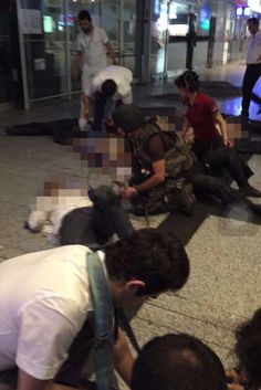 Paramedics and special forces officers at the scene help the more than 140 wounded at the ...