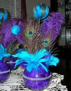 Purple and teal peakcock centerpieces.