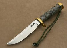 Knife by: Randall Made Knives Overall length: 266mm Blade length: 150mm Materials: stainless steel cap, brass.