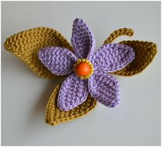 """Crochet flower """"Autumn Touch"""". All parts are sewn on a silver hair clip having a   3 cm opening. Flower diameter approx. 5cm"""