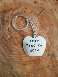 """Hand stamped apple shape key ring with """"BEST TEACHER 2016"""""""