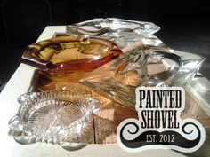 Assorted vintage glass ashtrays for sale at Painted Shovel in Avondale, AL.