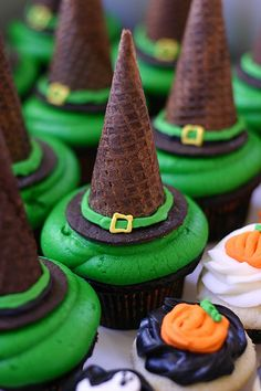 Halloween cupcakes with an upside-down chocolate ice cream cone used as a witch's hat.