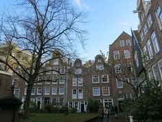 Hidden in the heart of Amsterdam are the peaceful garden courtyard and historic buildings of the Begijnhof. Find out more at:http://mikestravelguide.com/things-to-do-in-amsterdam-visit-the-hidden-garden-of-the-begijnhof/